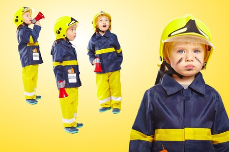Group of little boys in fireman costume Stock Photo
