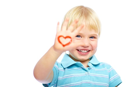 Happy kid with painted heart shape on his hand