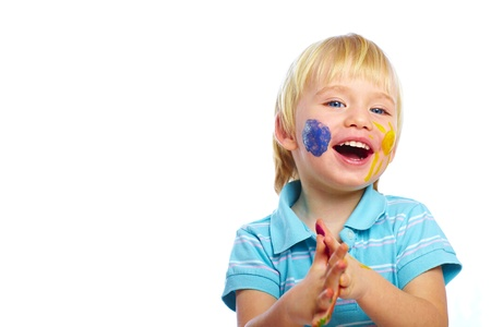 Happy kid with paints on face isolated on white