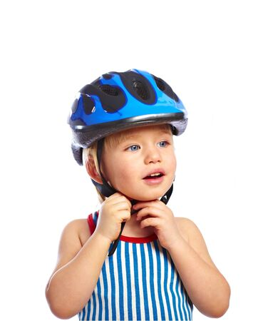 Little boy dress off a protective bikers helmet Stock Photo