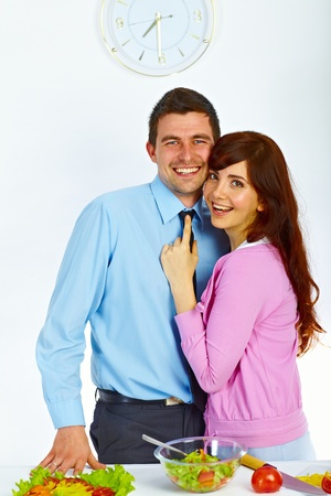 Beautiful couple are hugging and smiling on the kitchen Stock Photo