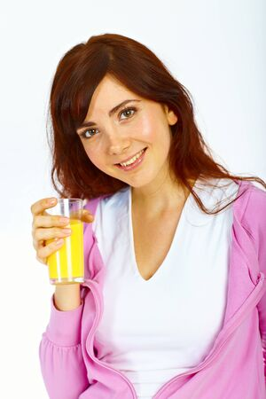 Portrait of beautiful young lady with glass of orange juice
