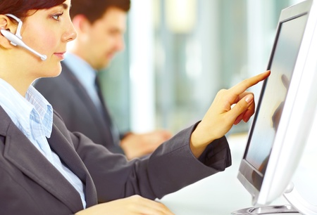 Image focused on hand of the customer support working in the office touching the screen
