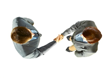 Two successful business people shaking hands with each other top view isolated over white background