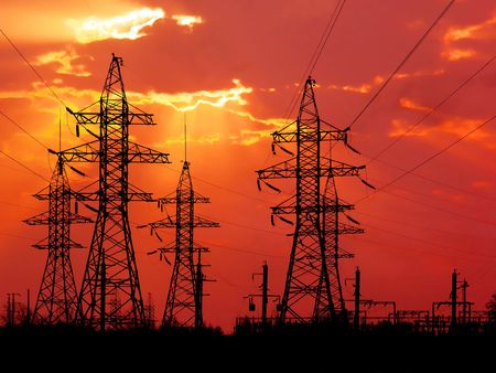 High-voltage towers on red sky background. photo