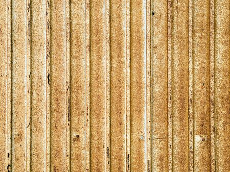 corrugated metal: Old rusted corrugated metal sheet.
