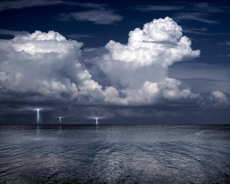 Lightning storm on a sea. photo