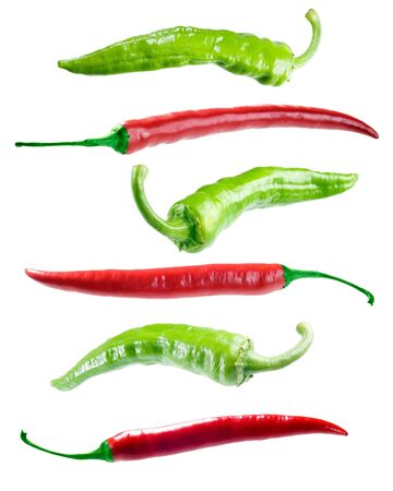 singly: Red and green peppers on white background (isolated).