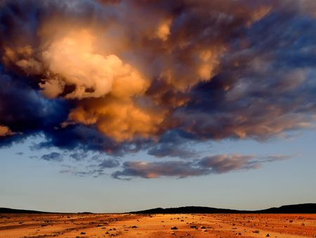 stony: Dark clouds over stony desert. Stock Photo