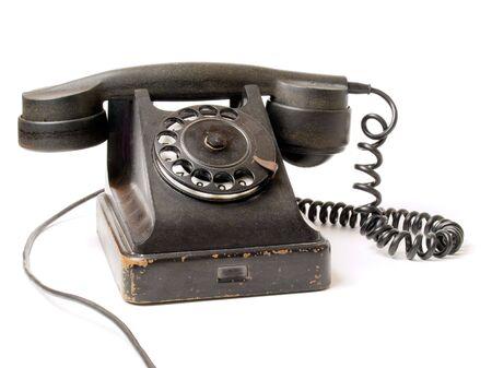 Old black telephone on white background (isolated). Stock Photo - 5683351