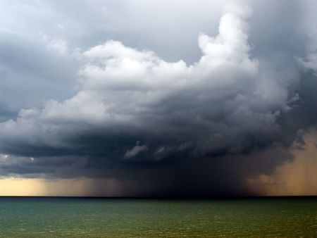 storm clouds: Rain over sea.