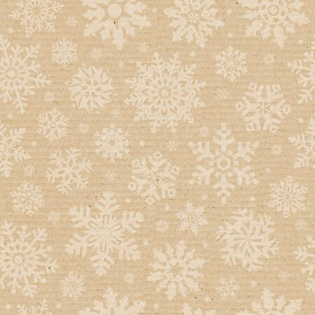 Seamless pattern with snowflake on packing cardboard background. photo