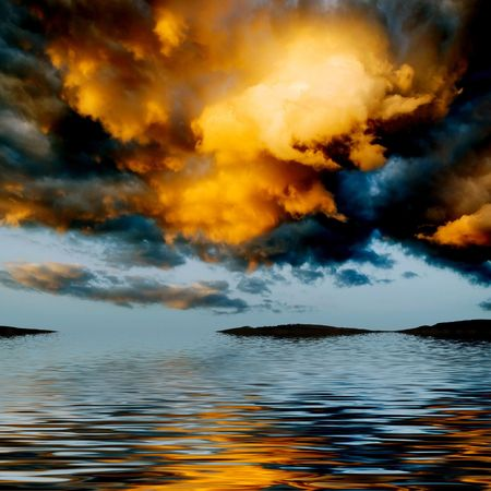 Orange clouds reflecting in the water. photo