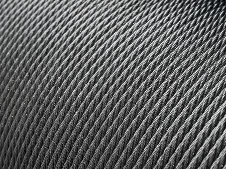 metal monochrome: Steel rope coil - abstract industrial background.
