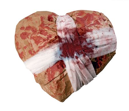 Blood-stained wrapped heart on white background (isolated). photo