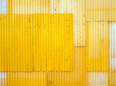 Texture background of yellow corrugated fence. photo