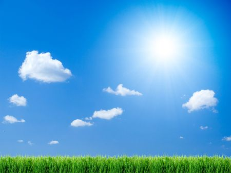 Green grass, sun and blue sky background. Stock Photo - 6752906