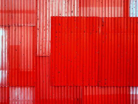 Texture background of red corrugated fence. photo