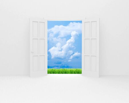 White open door, green field and blue sky with white clouds. photo