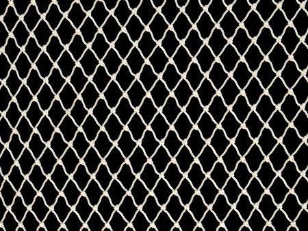 netting: White fishing net on black background. Stock Photo
