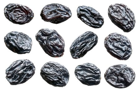 Black raisins set on white background. photo