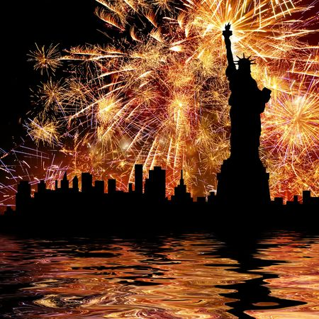 Silhouette statue of liberty on firework background. photo