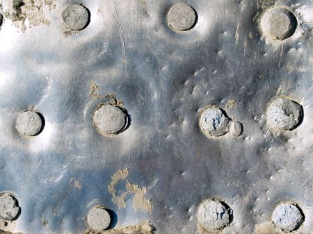 untidily: Riveted metal surface closeup background. Stock Photo