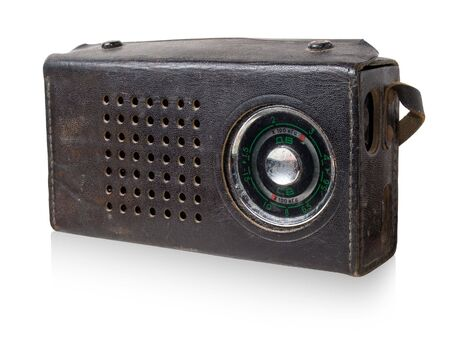 Vintage portable radio in black leather cover isolated on white background. photo