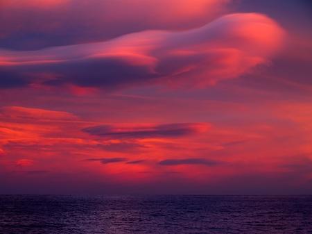 Unusual cloud over sea. photo
