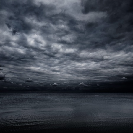 rainstorm: Dramatic dark sky over sea.