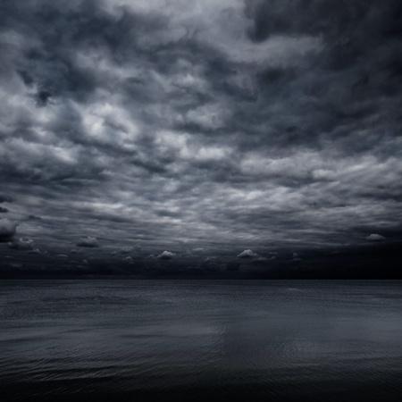 gloomy: Dramatic dark sky over sea.