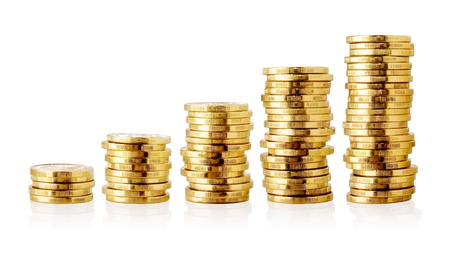 Stacks of golden coins isolated on white background. Stock Photo