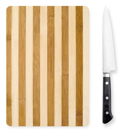 Bamboo chopping board and japanese knife isolated on white background. photo
