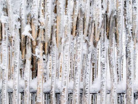 snowbound: Snowbound fence closeup texture background.