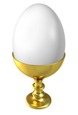 Boiled egg in golden cup isolated on white background  photo