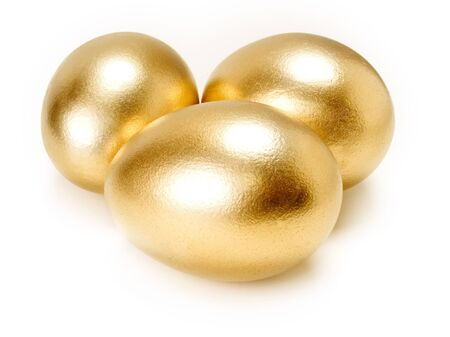 Golden eggs isolated on white background. Banque d'images