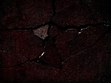 untidily: Cracked surface background.