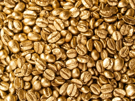 placer: Coffee beans gold closeup background.
