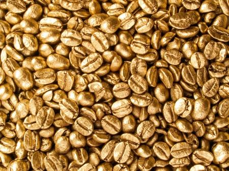 goldish: Coffee beans gold closeup background.
