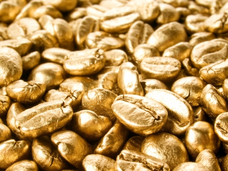 Coffee beans gold closeup background. photo