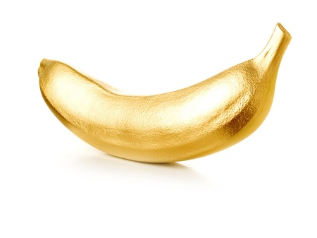 gilding: Golden banana isolated on white background.