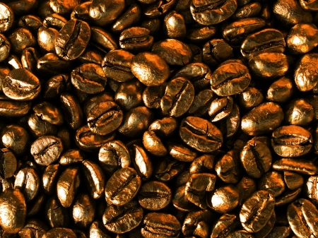 goldish: Coffee beans gold closeup background.