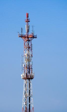 Communication tower on blue sky background. photo