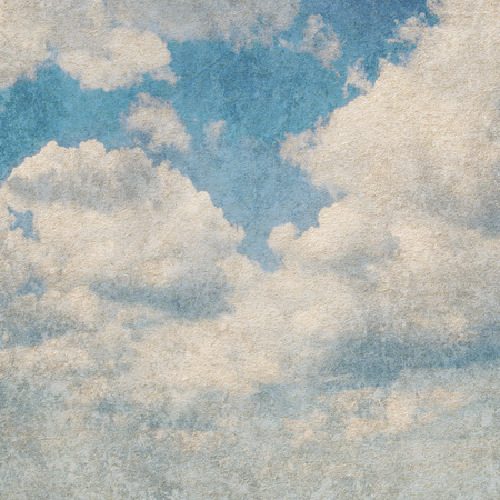 Blue sky on old paper background  photo