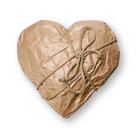 Heart packed in brown paper on white background  photo