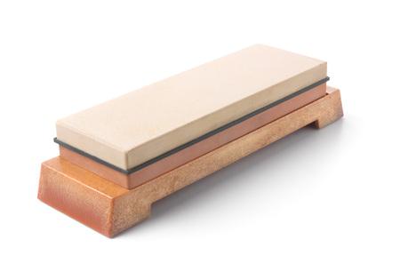 Japanese grinding stone on rest. Isolated on white.