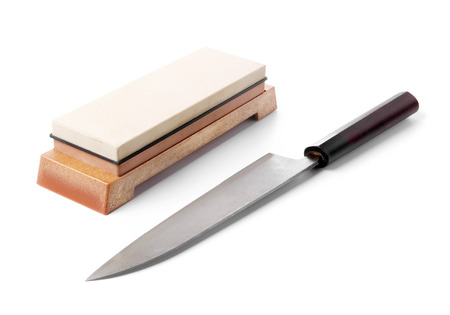 water stone: Traditional japanese kitchen knife and grinding water stone. Isolated on white.