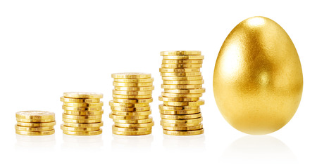 Gold goins and gold egg isolated on white/