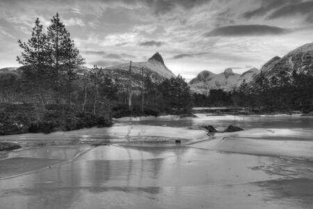 frozen river: Frozen river landscape with mountains