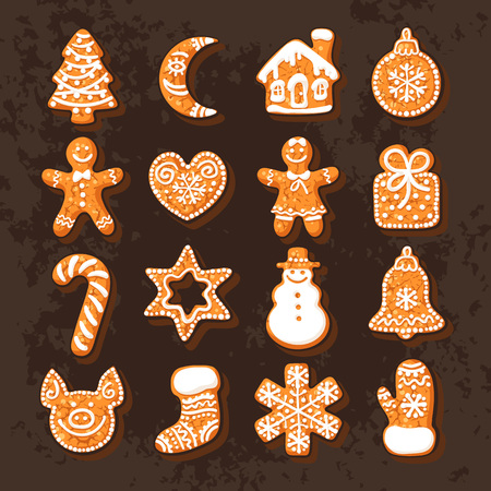 Set of cute traditional gingerbread Christmas cookies. Hand drawn vector illustration isolated on on dark brown chocolate background. 写真素材 - 127157769